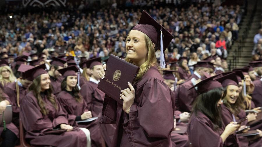 missouri state graduate smiling with diploma