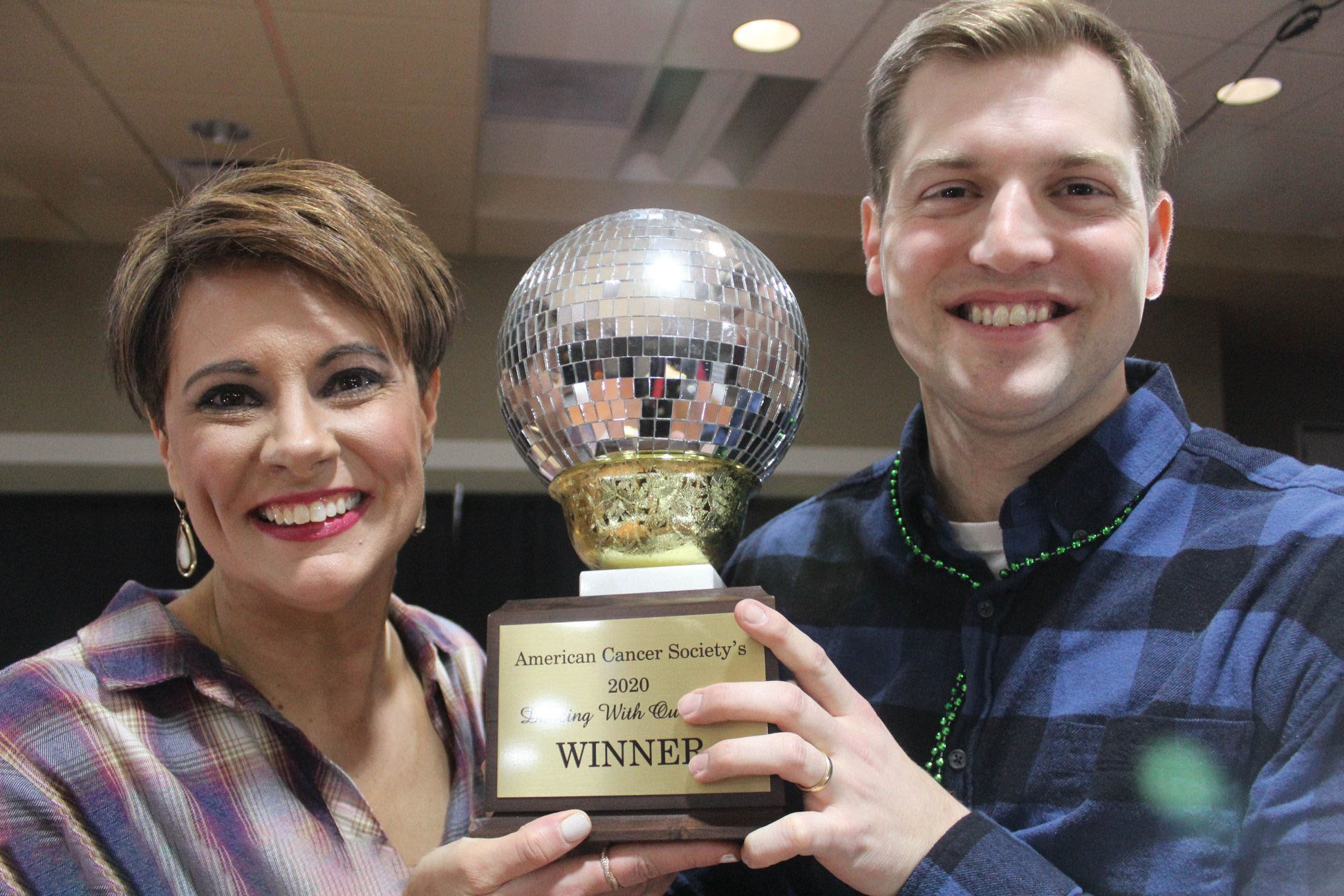 eric straub and trish childers-steckrider smile with trophy