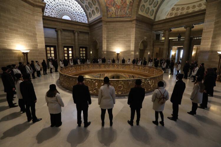 Chorale members practice in State Capitol Rotunda
