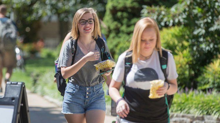 Zoe walking to class