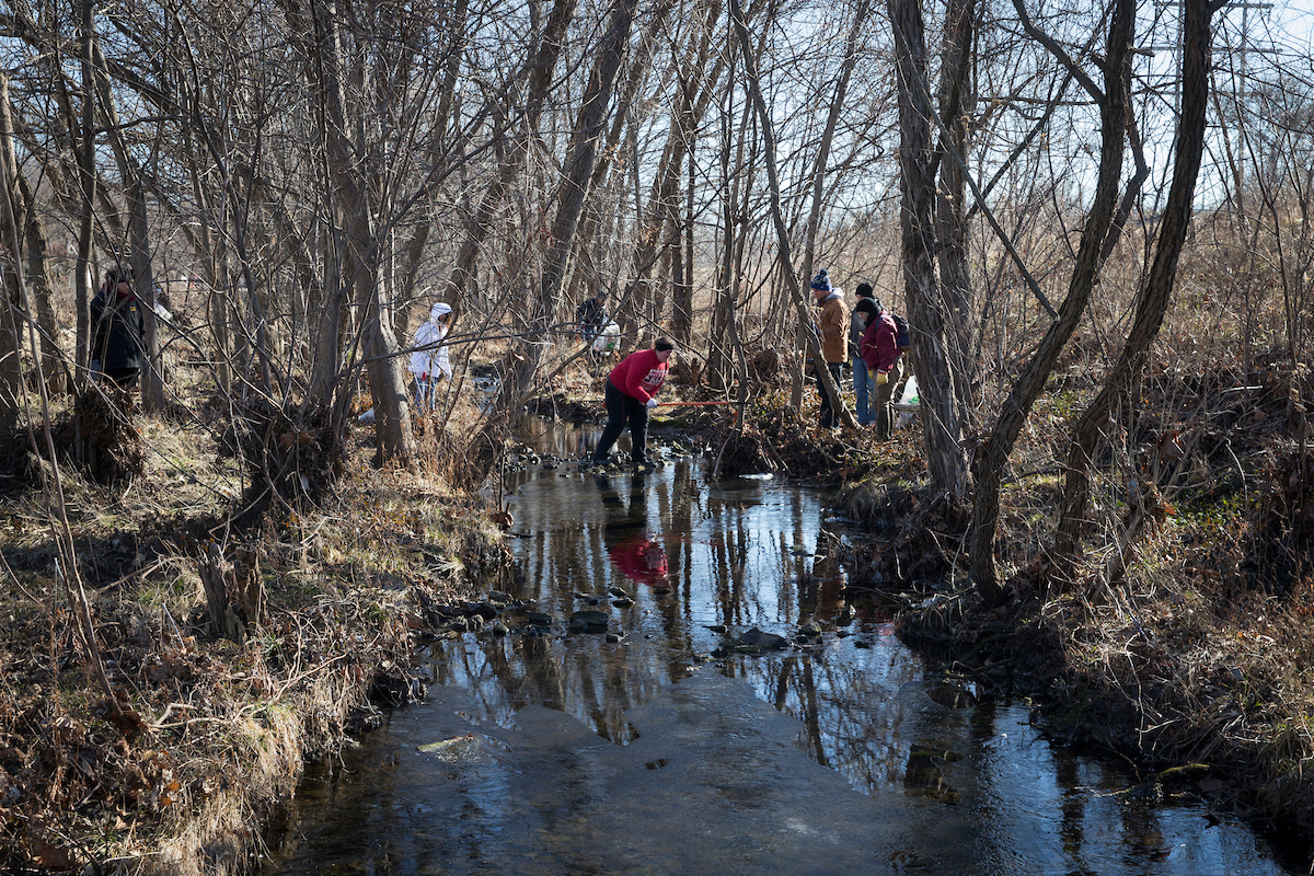 Students by a creek