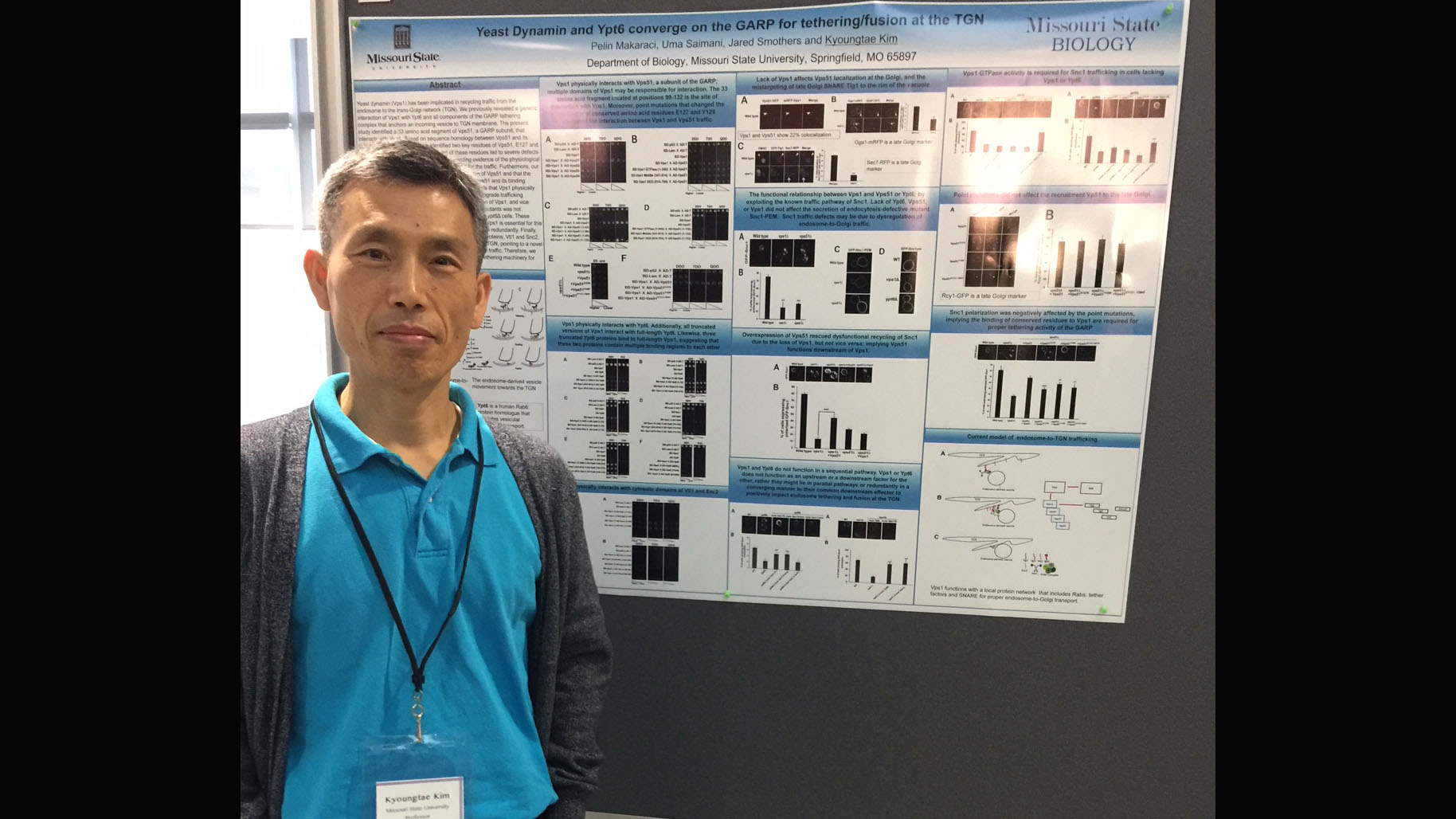 Dr. Kim with his poster