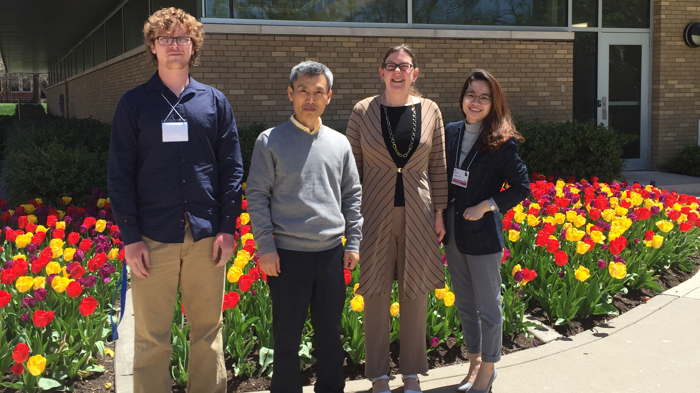 Cullen Horstmann, Dr. Kyoungtae Kim, Dr. Tamera Jahnke and Vy Nguyen pose for a photo