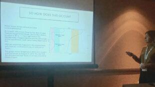 Biology student Alexandria Beezel presents her original research.