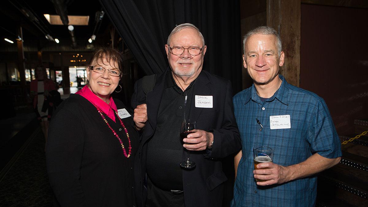 Steven Jensen with wife Nancy Jensen and coworker John Havel