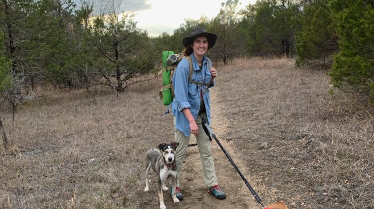 Parker Campbell hikes on trail with her dog.
