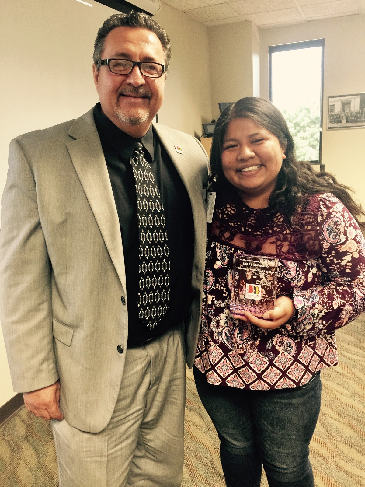 Alvarado receives the Outstanding Health P.A.S.S. Student of 2017 award from Dr. Rich Salas