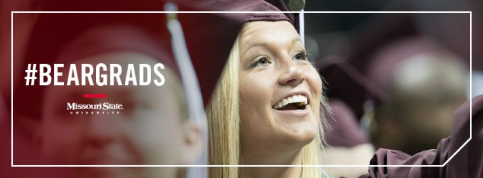 Facebook cover: A female graduate smiles at her family