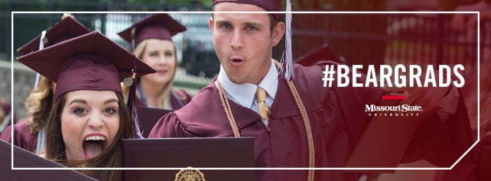 Facebook cover: Two graduates celebrating outside JQH Arena