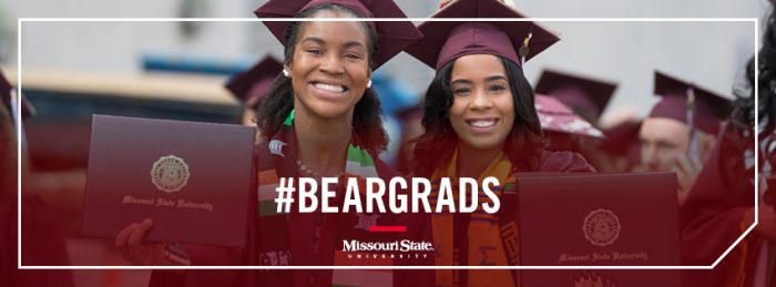 Facebook cover: Two graduates holding up their degree covers
