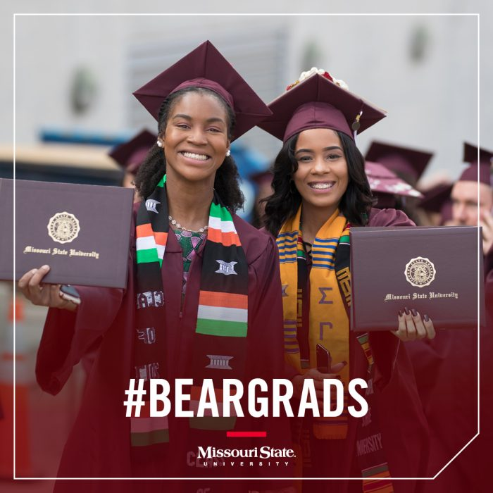 Instagram image: Two graduates holding up their degree covers