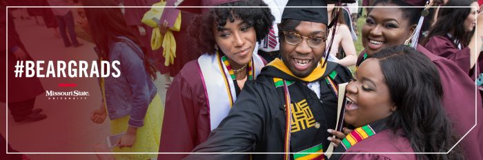 Twitter header: Graduates taking a selfie