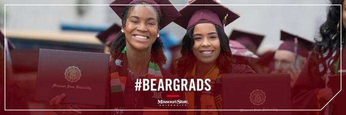 Twitter header: Two graduates holding up their degree covers