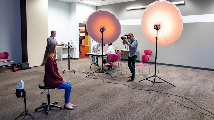 Missouri State University employee having photo taken during free staff and faculty portrait days event.
