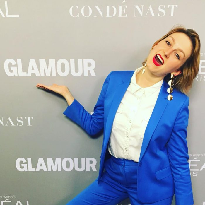 Emily Geraghty in front of Glamour logo