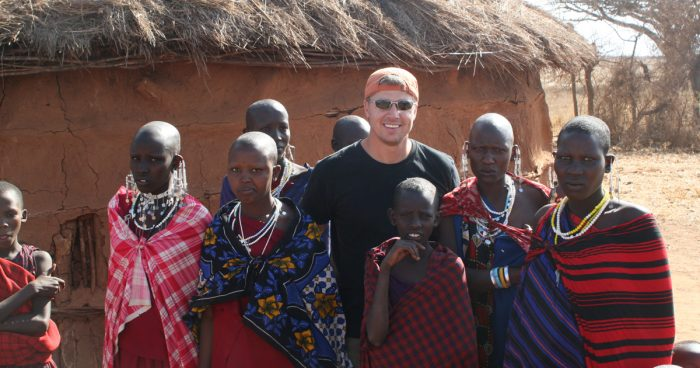 Doug Pitt with children in Africa
