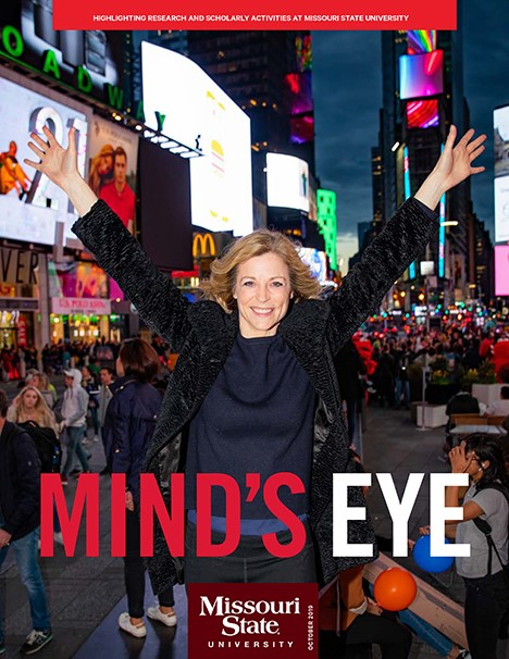 Cover of 2019 Mind's Eye, featuring Lisa Brescia in NYC's Times Square.