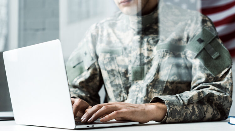 Military person on laptop