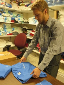 Bradley prepares T-shirts for an event.
