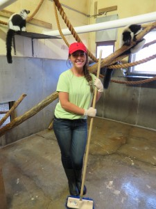 Katlyn cleans the lemurs' enclosure.