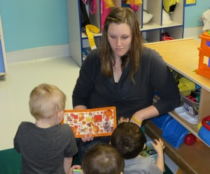 Lindsey engages the kids with a book.