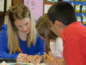 Kristin helps students with an assignment.