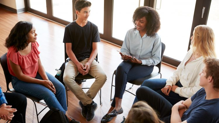 students seated in a dialogue circle