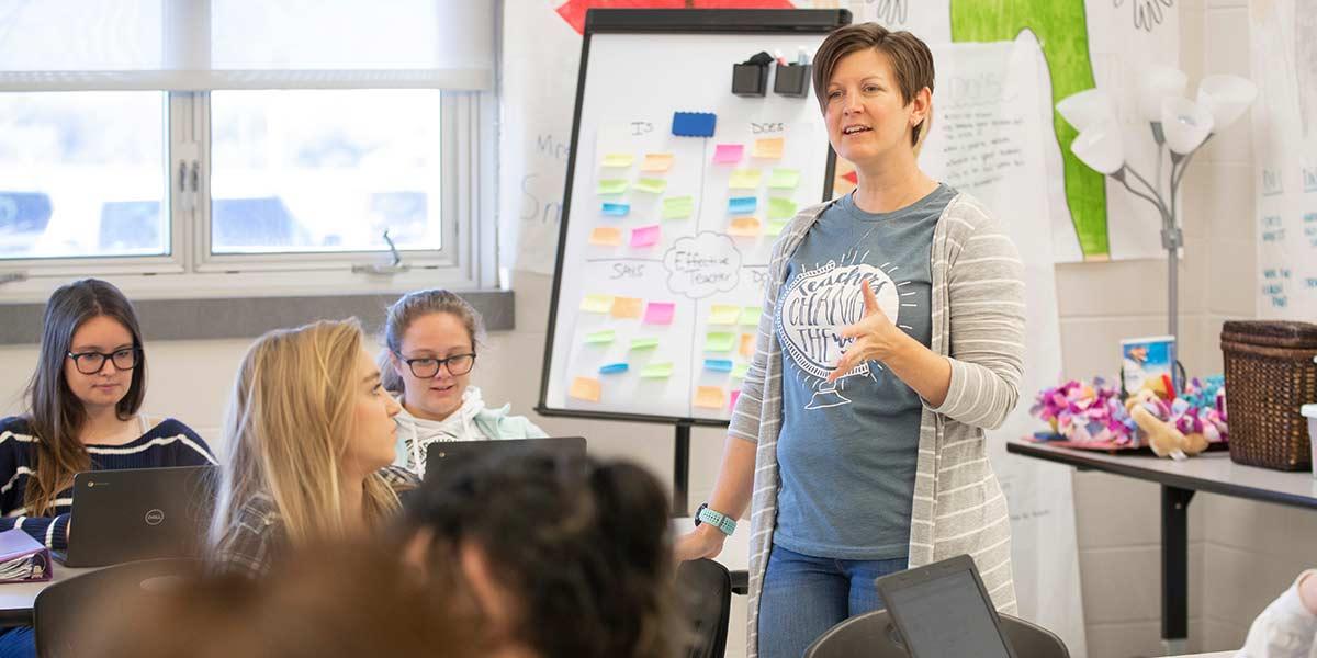 Jennifer Baxter teaching in class.