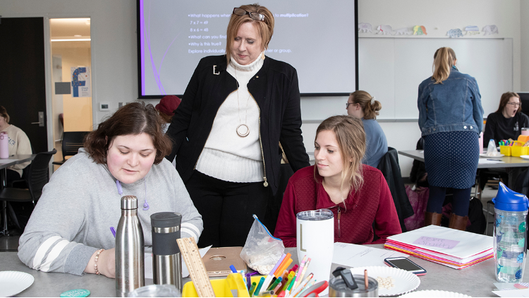 Dr. Stefanie Livers works with students in class.