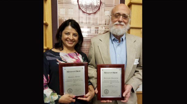 Drs. Mahua Mitra and Richard Biagioni smile with their awards.