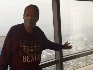 Sporting Bearwear and showing pollution outside window