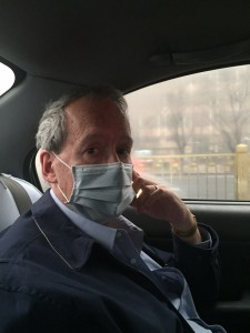 Taxi ride with pollution mask.