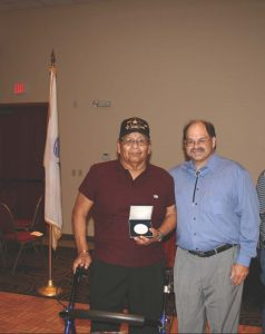 Dr. Meadows with Joseph R. Day Jr. (Laguna), holding the Laguna Code Talker Congressional Gold Medal.