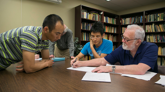 Mathematics Professors and Students meet to discuss difficult math problem in Cheek Hall on Thursday, April 28, 2016.
