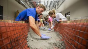 Engineering students participating in the Concrete Canoe project