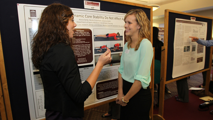 Students discussing a poster