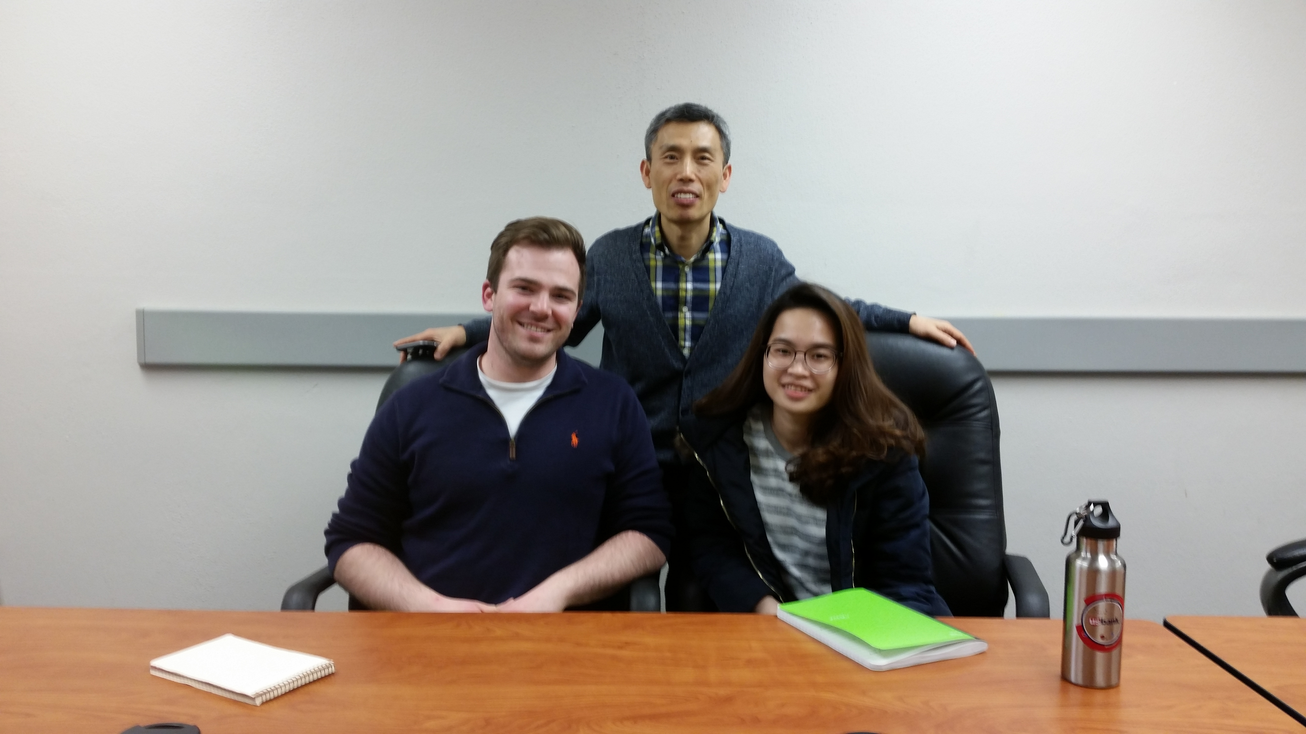 Greg Illy, Dr. Kyoungtae Kim, and Vy Nguyen pose for a photo