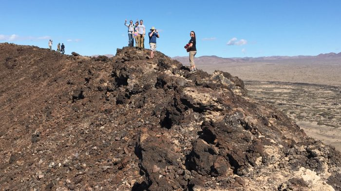 Students explore Amboy Crater, a cinder cone volcano in the Mojave Desert.