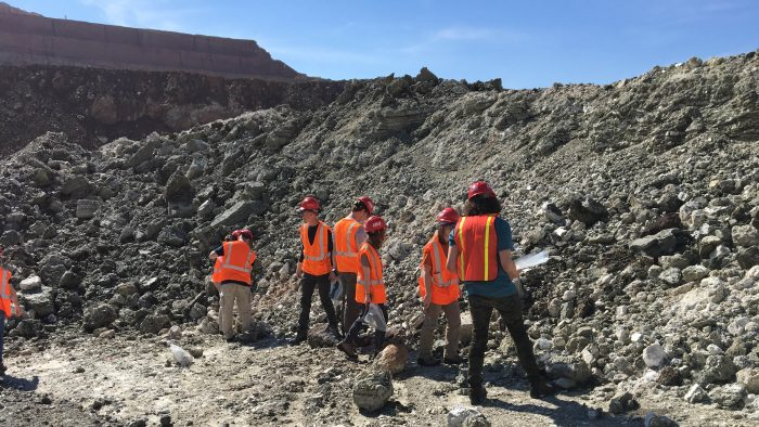 Students collect borate minerals in California's largest open mine pit.