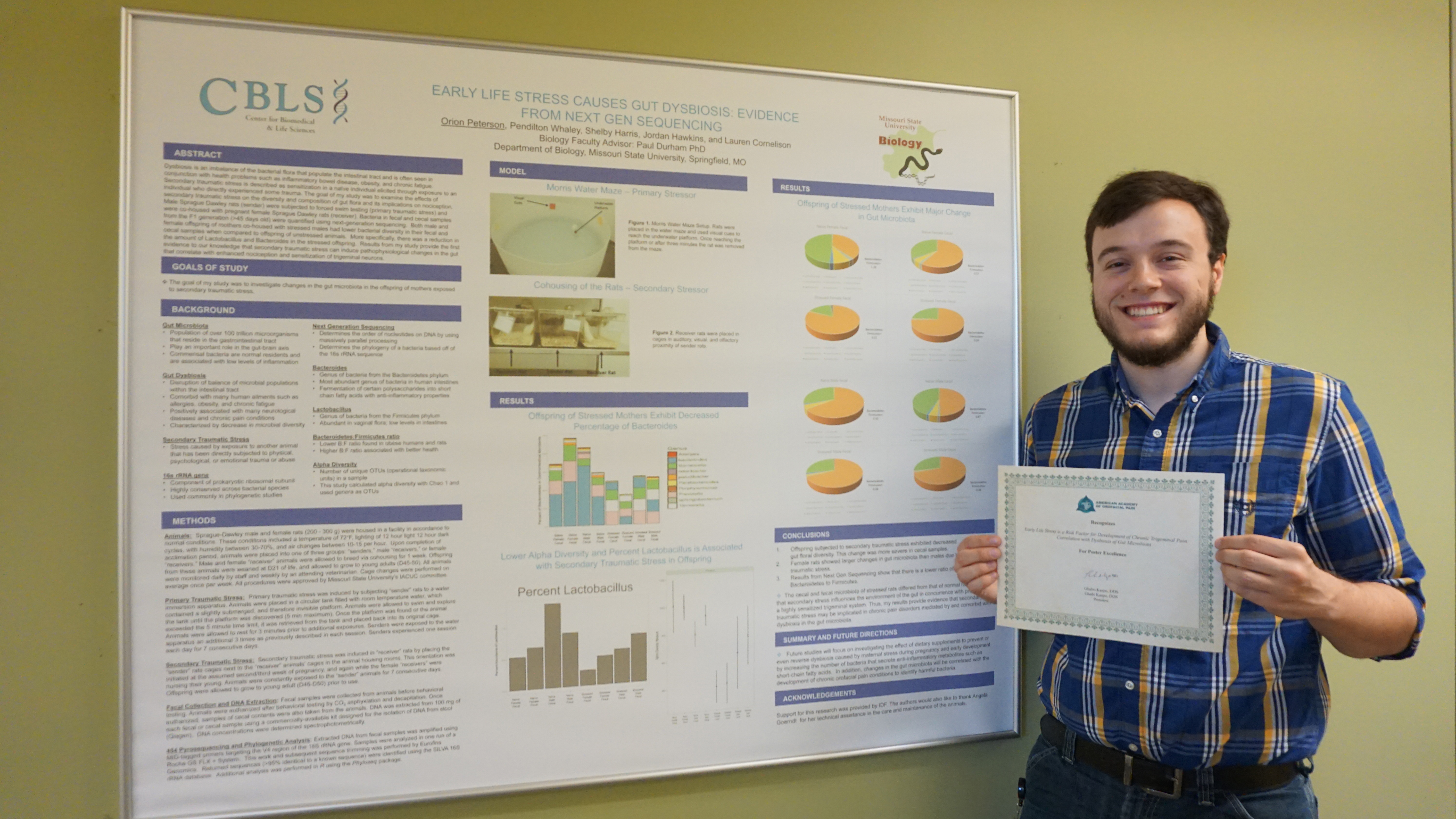 Orion Peterson stands with his award winning presentation.