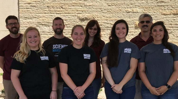 Current and former biology students attend conference
