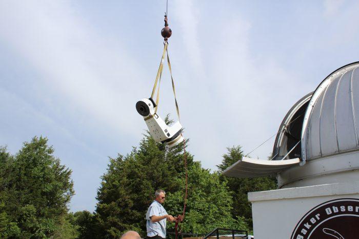 putting telescope into building