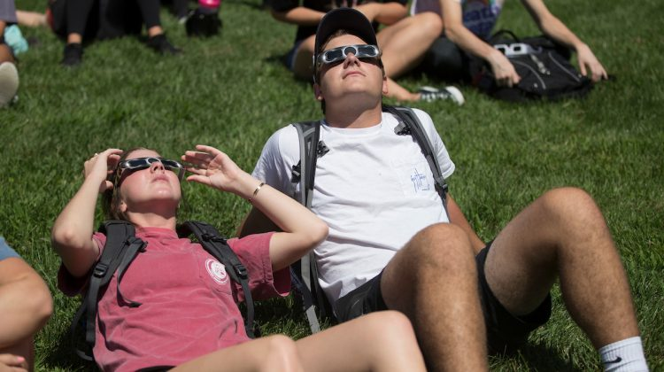 Students watch the solar eclipse