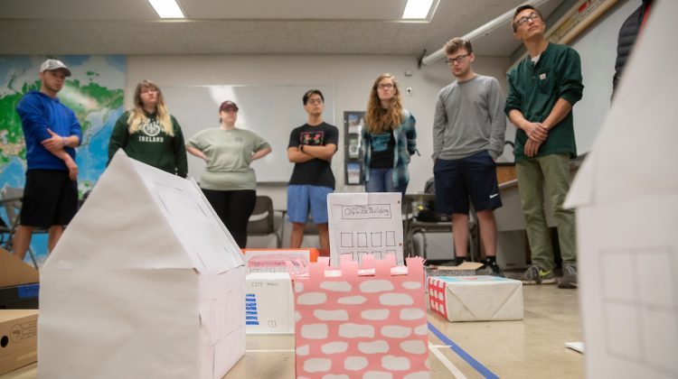 Students behind a planning project