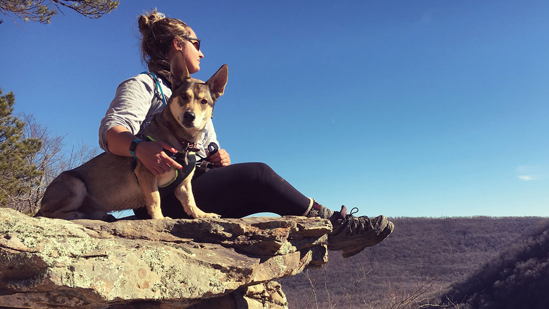 Sage with her dog on a rock
