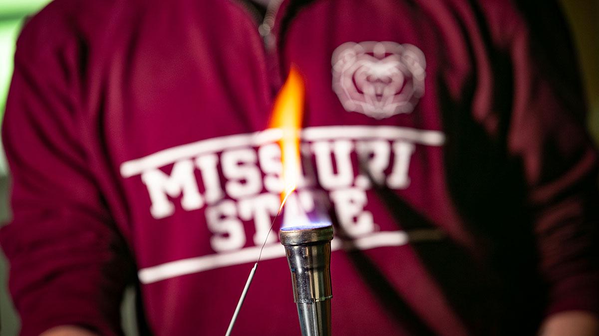 biology student ignites flame