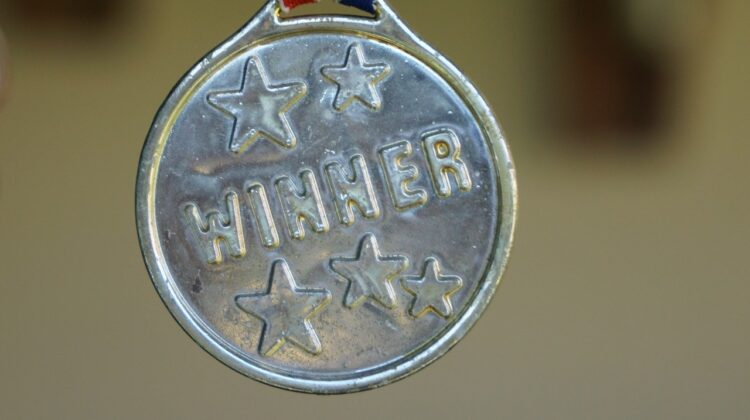 "An award medallion labeled ""winner."""