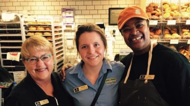 Jennifer Johnson (middle) with coworkers at Panera bakery-café opening.