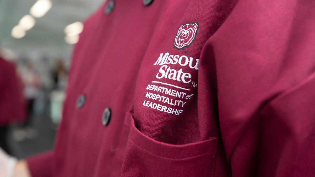 A student adorns a Missouri State University Department of Hospitality Leadership uniform while working in Carrie's Café.