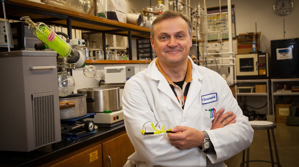 Dr. Nikolay Gerasimchuk poses in his lab surrounded by research equipment.